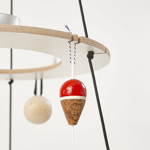 Detail of Josef, the wooden Christmas tree, in white with black ropes. Decorated with a red fishing float made from cork that hangs from one of the milled hooks.