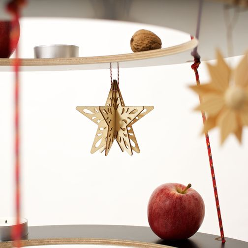 Josef sustainable Christmas tree in black with wooden stars and apples as tree decorations