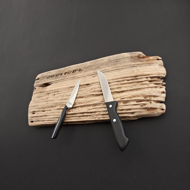 Driftwood with magnets as a knife board and knife strip, geographic coordinates burned into the wood with a branding iron