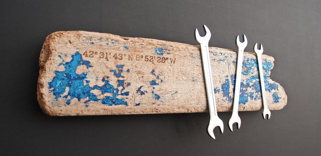 Driftwood with magnets from Galicia, Spain as magnetic strip for tools, knives, keys. Geographical coordinates with a Branding iron burned into the wood