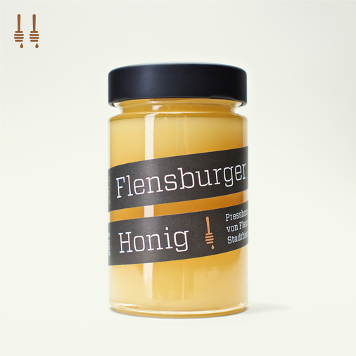 Two jars of Flensburger Honig, pressed honey coming from urban beekeeping in Flensburg