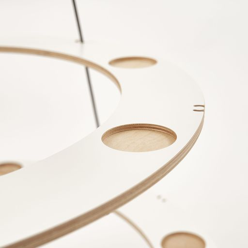 Detail of the sustainable wooden Christmas tree in Scandinavian design. Recesses in wood for classic or LED tealights.